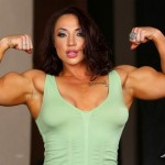 Brandi Mae flexing her biceps